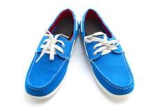 蓝色人鞋子 免版税库存图片