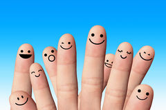 在蓝色背景的愉快的手指。友谊概念。 免版税库存照片