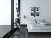 Εσωτερικό κρεβατοκάμαρων με τα σύγχρονα έπιπλα και το κρεβάτι Στοκ Φωτογραφία