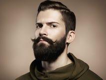 英俊的人画象有胡子的 图库摄影