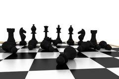 Упаденные черные пешки на шахматной доске Стоковые Изображения RF
