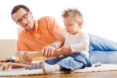 儿童父亲使用 免版税库存图片