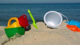 孩子的被设置使用在沙子 免版税图库摄影