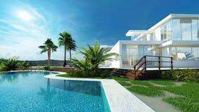 有一个热带庭院和水池的豪华房子 图库摄影