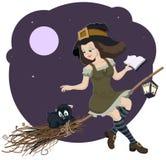 有猫的美丽的年轻巫婆的扫帚 库存照片