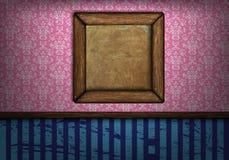 在墙壁上的框架在屋子葡萄酒里 免版税库存图片