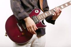 吉他弹奏者作用 库存图片
