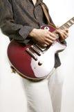 吉他弹奏者作用 免版税库存照片