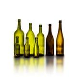 在白色背景的空的玻璃酒瓶 免版税库存照片