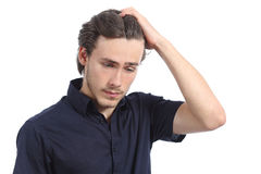 担心的沮丧的人用在头的手 库存照片