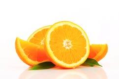 Πορτοκαλιά μισά και σφήνες Στοκ φωτογραφίες με δικαίωμα ελεύθερης χρήσης