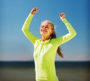 庆祝胜利的妇女赛跑者 库存图片