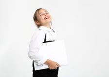 快乐的女小学生 库存图片