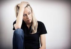 消沉的年轻不快乐的妇女 库存图片