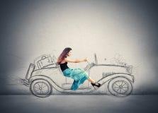 驾驶的时尚女孩 免版税库存图片