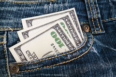 Деньги в карманн джинсыов Стоковое Изображение RF