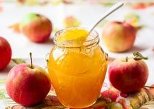λευκό φωτογραφιών μαρμελάδας ανασκόπησης μήλων Στοκ Εικόνα
