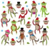 逗人喜爱的圣诞节主题的袜子猴子的传染媒介汇集 库存图片