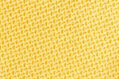 金黄颜色丝绸布料纹理 免版税库存照片