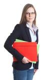 有玻璃和五颜六色的文件的女实业家 免版税库存图片
