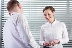 在工作期间的愉快的企业工友 免版税库存图片