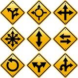 与箭头方向的菱形黄色路标 免版税库存图片