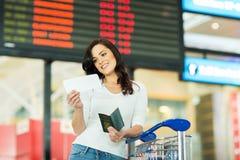妇女飞机票机场 图库摄影