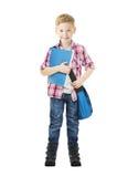 拿着书的男小学生孩子 学生男生被隔绝的白色 免版税库存照片