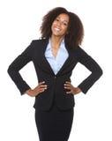 一年轻黑女商人微笑的画象 库存图片