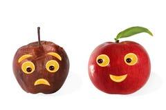 创造性的食物 由苹果做的正面和消极画象 免版税库存照片