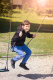 Мальчик в спортивной площадке Стоковое Изображение RF