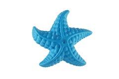 一个蓝色海星的特写镜头在白色的 免版税库存图片