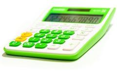 在白色背景隔绝的绿色数字式计算器 免版税库存图片