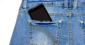 巧妙的电话在蓝色牛仔裤的口袋 库存照片
