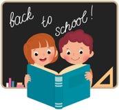 Дети на школе читая книгу Стоковые Изображения