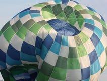 紧缩通货的热空气气球 免版税库存照片