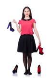 Женщина пробуя новые изолированные ботинки Стоковые Изображения RF