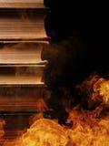堆在灼烧的火的书 库存图片