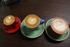 Μωρό, μαμά, καφές μπαμπάδων Στοκ Εικόνες