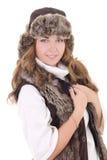在白色和背心的美丽的妇女隔绝的裘皮帽 免版税库存照片
