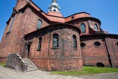 古老的天主教堂的砖墙 免版税库存照片