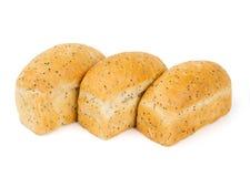 与蓝色鸦片的三个小圆面包 免版税库存照片