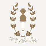 Портняжничать эмблему с манекеном или куклой Стоковое Изображение