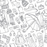 在无缝的样式的外套和衣物辅助部件 免版税库存图片