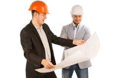 对计划负的建筑师观看由他的伙伴 库存照片