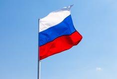 Русский флаг развевая в ветре Стоковая Фотография RF
