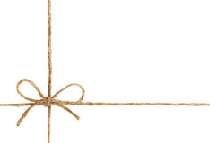 在弓或麻线栓的串隔绝在白色 库存照片