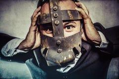 Менеджер, опасный бизнесмен с железной маской и выражения Стоковая Фотография