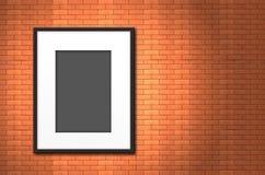 在老砖墙上的照片框架 库存图片