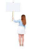 的妇女显示标志板的后面观点 免版税库存图片